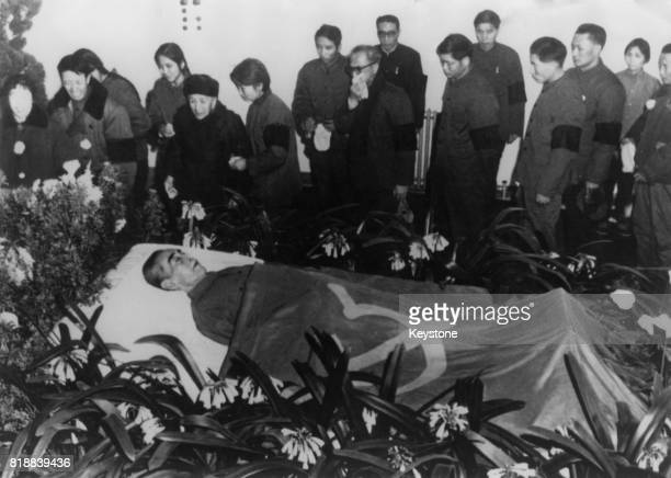 Zhou Enlai , Premier of the People's Republic of China, lies in state in a hospital in Peking , draped in the Communist flag, January 1976.