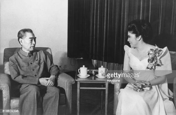 Zhou Enlai , Premier of the People's Republic of China, receives a visit from Imelda Marcos, wife of the President of the Philippines, during his...