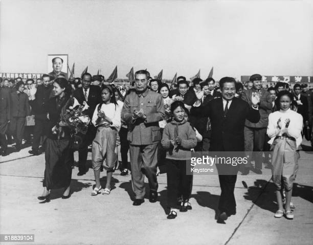 Zhou Enlai , Premier of the People's Republic of China, welcomes Prince Norodom Sihanouk of Cambodia to Peking Airport after his inspection tour of...
