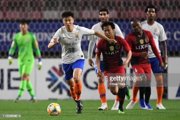 Zhou Hai Bin of Shandong Luneng controls the ball during the AFC Champions League Group E match between Kashima Antlers and Shandong Luneng at...