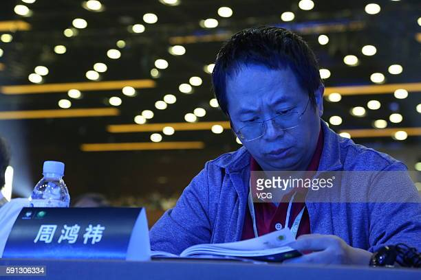 Zhou Hongyi CEO of Qihoo 360 Technology Co Ltd listens to the speech during the China Internet Security Conference on August 16 2016 in Beijing China...