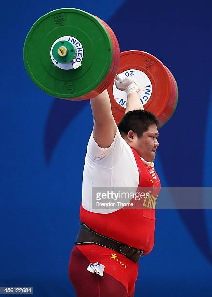 Zhou Lulu of China wins Gold whilst breaking the world record for the Clean & Jerk in the Women's +75kg Final during day seven of the 2014 Asian...