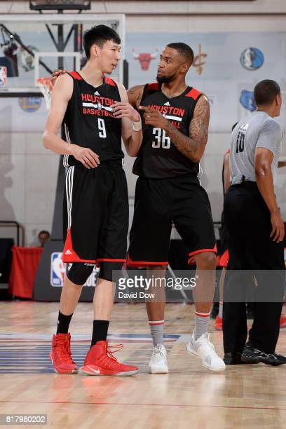 Zhou Qi and Shawn Long of the Houston Rockets speak in a game against the Denver Nuggets during the 2017 Las Vegas Summer League on July 7 2017 at...