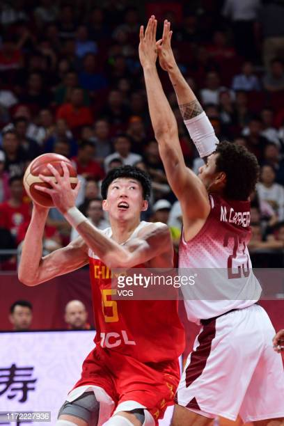 Zhou Qi of China handles the ball against Michael Carrera of Venezuela during FIBA World Cup 2019 Group A match between Venezuela and China at...