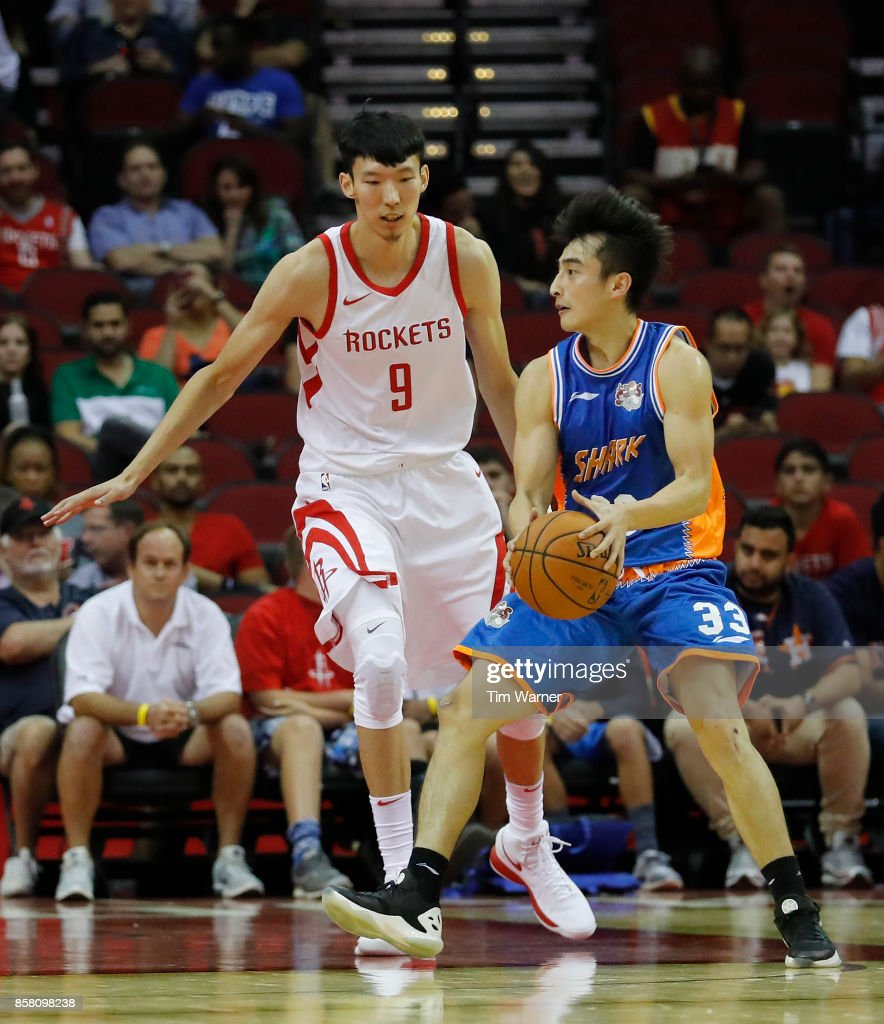 Zhou Qi #9 of Houston Rockets defends Luo Hanchen #33 of Shanghai Sharks in the first half at Toyota Center on October 5, 2017 in Houston, Texas.