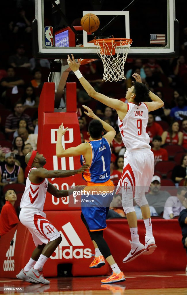 Zhou Qi #9 of Houston Rockets goes up for a rebound against Cai Liang #1 of Shanghai Sharks in the second quarter at Toyota Center on October 5, 2017 in Houston, Texas.