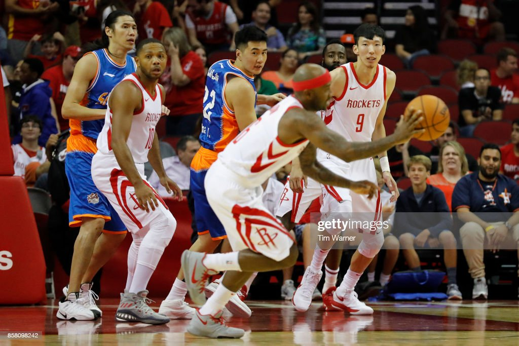 Zhou Qi #9 of Houston Rockets reacts to blocking a shot by Zhai Yi #22 of Shanghai Sharks in the first half at Toyota Center on October 5, 2017 in Houston, Texas.