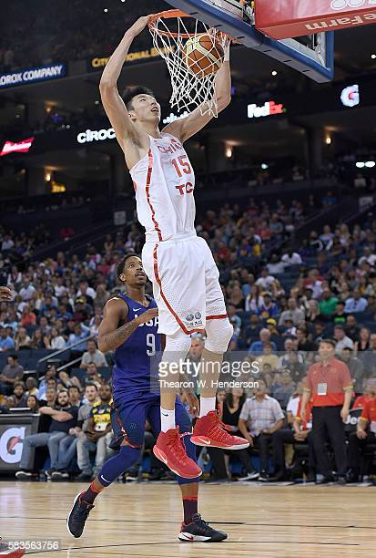 Zhou Qi of the China Men's National Team goes up for a slam dunk against United States Men's National Team during the second half of a USA Basketball...