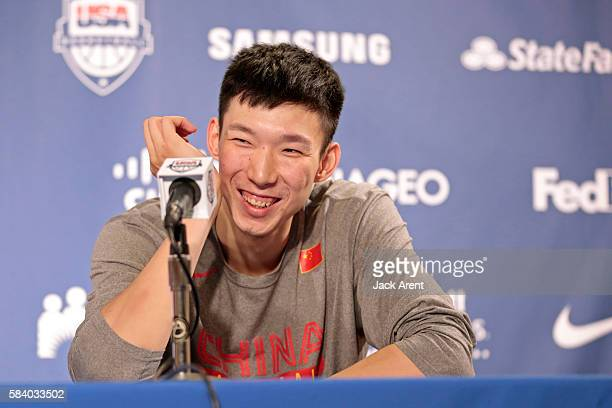 Zhou Qi of the Chinese Men's National Team talks to the media during a press conference after the game against the USA Men's National Team during the...