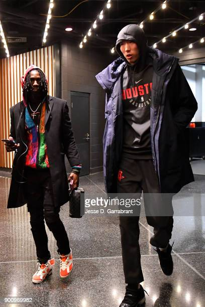 Zhou Qi of the Houston Rockets and Briante Weber arrive at the stadium before the game against the Boston Celtics of the Boston Celtics during the...