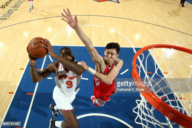 Zhou Qi of the Houston Rockets attempts to block a shot against the New York Knicks during the preseason game on October 9 2017 at Madison Square...