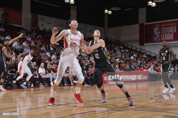 Zhou Qi of the Houston Rockets battles for position against Yuta Watanabe of the Brooklyn Nets during the 2018 Las Vegas Summer League on July 11...