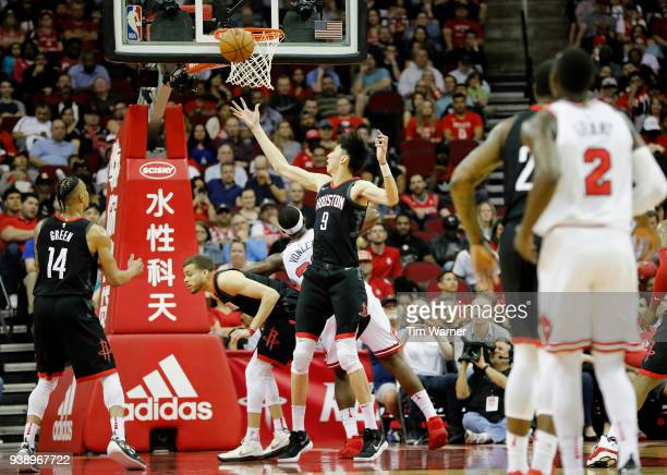 Zhou Qi of the Houston Rockets battles Noah Vonleh of the Chicago Bulls for a rebound in the second half at Toyota Center on March 27 2018 in Houston...