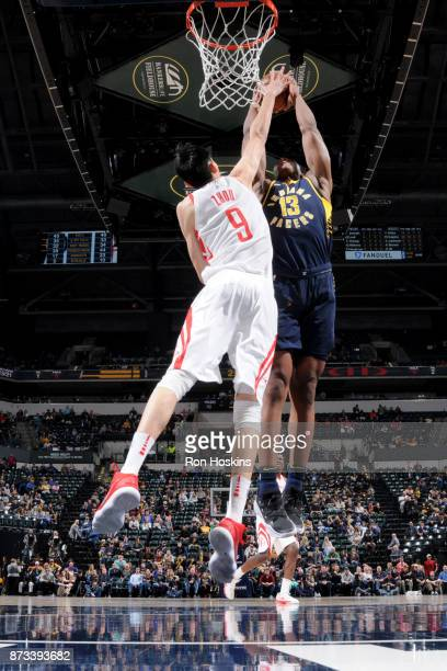 Zhou Qi of the Houston Rockets blocks the shot against Ike Anigbogu of the Indiana Pacers on November 12 2017 at Bankers Life Fieldhouse in...