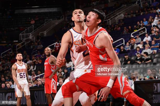 Zhou Qi of the Houston Rockets boxes out against the Phoenix Suns on November 16 2017 at Talking Stick Resort Arena in Phoenix Arizona NOTE TO USER...