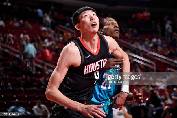 Zhou Qi of the Houston Rockets boxes out during the game against the Charlotte Hornets on December 13 2017 at the Toyota Center in Houston Texas NOTE...