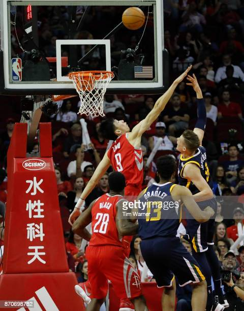 Zhou Qi of the Houston Rockets defends a shot by Jonas Jerebko of the Utah Jazz in the second half at Toyota Center on November 05 2017 in Houston...