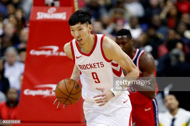Zhou Qi of the Houston Rockets dribbles the ball against the Washington Wizards at Capital One Arena on December 29 2017 in Washington DC NOTE TO...