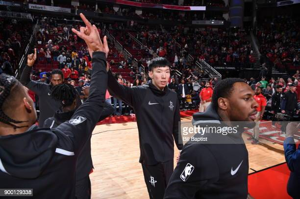 Zhou Qi of the Houston Rockets gets introduced before the game against the Los Angeles Lakers on December 31 2017 at the Toyota Center in Houston...