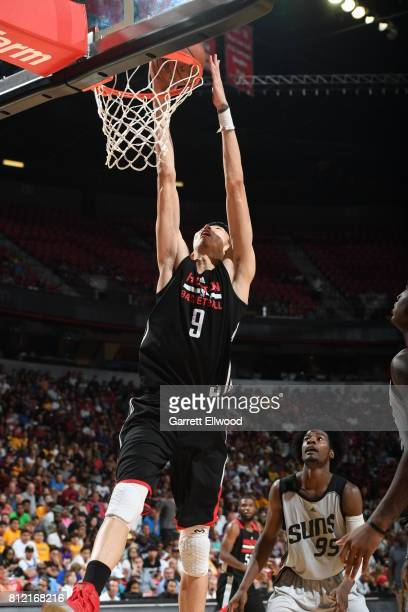 Zhou Qi of the Houston Rockets goes to the basket against the Phoenix Suns on July 10 2017 at the Thomas Mack Center in Las Vegas Nevada NOTE TO USER...