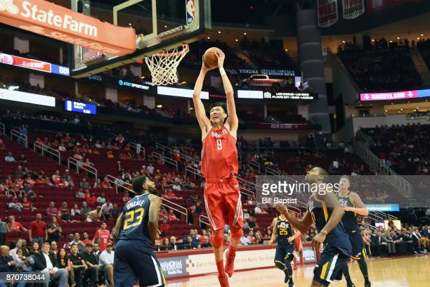 Zhou Qi of the Houston Rockets goes to the basket against the Utah Jazz on November 5 2017 at the Toyota Center in Houston Texas NOTE TO USER User...