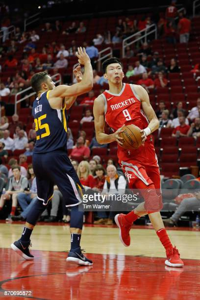 Zhou Qi of the Houston Rockets goes up for a lay up defended by Raul Neto of the Utah Jazz in the second half at Toyota Center on November 05 2017 in...