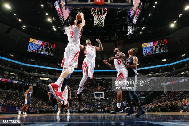 Zhou Qi of the Houston Rockets grabs a rebound against the Memphis Grizzlies on October 28 2017 at FedExForum in Memphis Tennessee NOTE TO USER User...