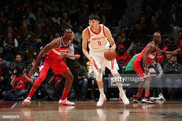 Zhou Qi of the Houston Rockets handles the ball against Ian Mahinmi of the Washington Wizards on December 29 2017 at Capital One Arena in Washington...