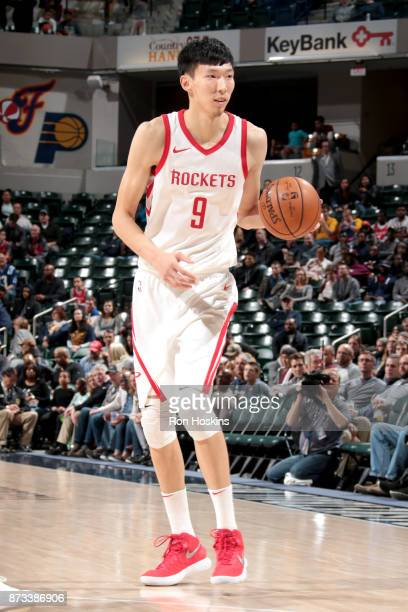 Zhou Qi of the Houston Rockets handles the ball against the Indiana Pacers on November 12 2017 at Bankers Life Fieldhouse in Indianapolis Indiana...