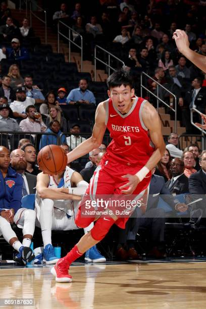 Zhou Qi of the Houston Rockets handles the ball against the New York Knicks on November 1 2017 at Madison Square Garden in New York City New York...