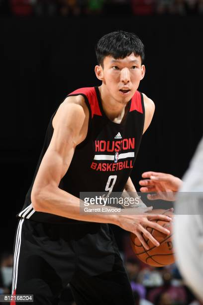 Zhou Qi of the Houston Rockets handles the ball against the Phoenix Suns on July 10 2017 at the Thomas Mack Center in Las Vegas Nevada NOTE TO USER...