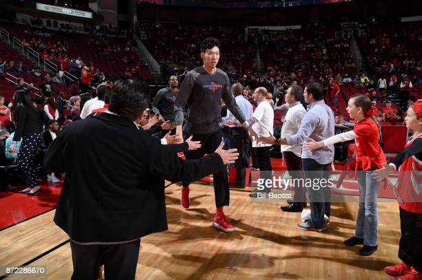 Zhou Qi of the Houston Rockets high fives fans before the game against the Cleveland Cavaliers on NOVEMBER 9 2017 at the Toyota Center in Houston...