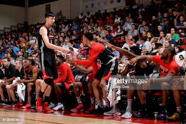 Zhou Qi of the Houston Rockets high fives his teammates during the game against the Denver Nuggets during the 2017 Las Vegas Summer League on July 7...