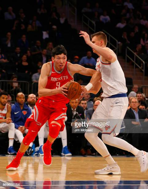 Zhou Qi of the Houston Rockets in action against Kristaps Porzingis of the New York Knicks at Madison Square Garden on November 1 2017 in New York...