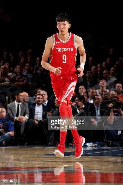 Zhou Qi of the Houston Rockets looks on during the game against the New York Knicks on November 1 2017 at Madison Square Garden in New York City New...