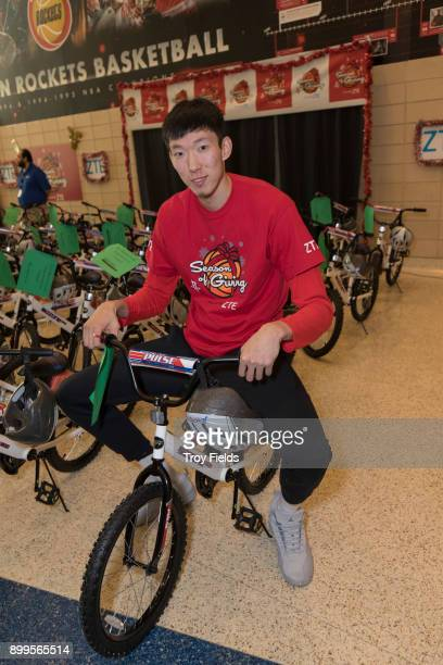 Zhou Qi of the Houston Rockets participates in the 2017 Season of Giving presented by ZTE with a holiday party and a surprise bike giveaway on...
