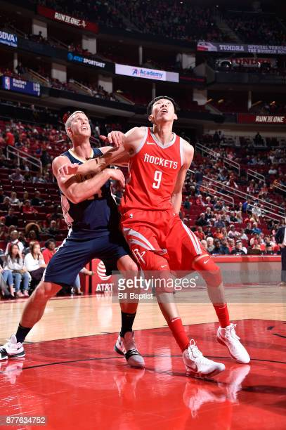 Zhou Qi of the Houston Rockets plays defense against Mason Plumlee of the Denver Nuggets on November 22 2017 at the Toyota Center in Houston Texas...