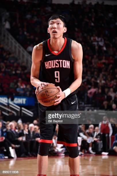 Zhou Qi of the Houston Rockets shoots a free throw during the game against the San Antonio Spurs on December 15 2017 at the Toyota Center in Houston...