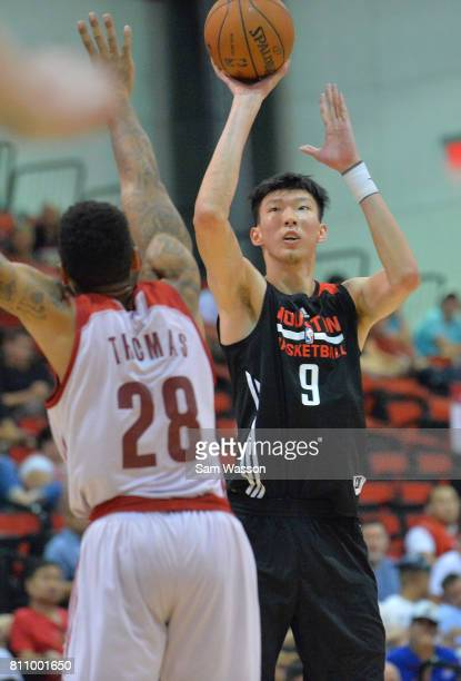 Zhou Qi of the Houston Rockets shoots against Malcolm Thomas of the Cleveland Cavaliers during the 2017 Summer League at the Cox Pavilion on July 8...