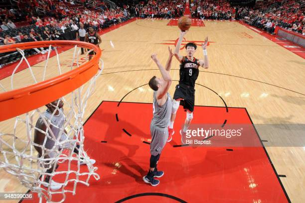 Zhou Qi of the Houston Rockets shoots the ball against the Minnesota Timberwolves during Game Two of Round One of the 2018 NBA Playoffs on April 18...