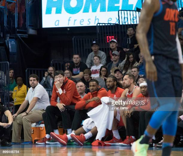 Zhou Qi of the Houston Rockets sits on the bench during the second half of a NBA game at the Chesapeake Energy Arena on December 25 2017 in Oklahoma...