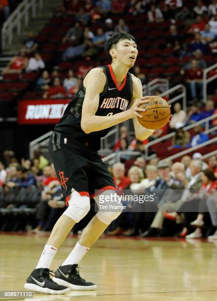 Zhou Qi of the Houston Rockets takes a three point shot in the second half against the Chicago Bulls at Toyota Center on March 27 2018 in Houston...