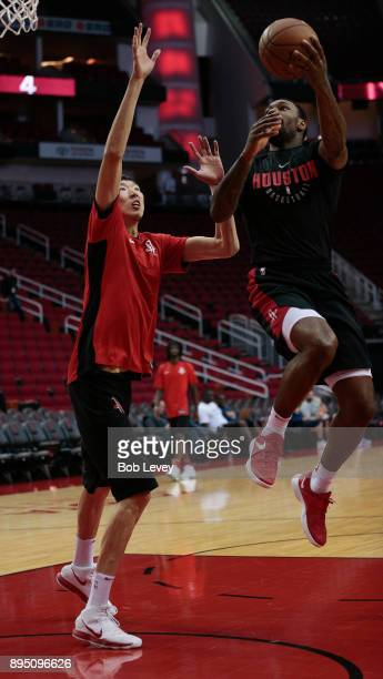 Zhou Qi of the Houston Rockets warms up before playing the Utah Jazz at Toyota Center on December 18 2017 in Houston Texas NOTE TO USER User...