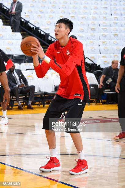 Zhou Qi of the Houston Rockets warms up before the game against the Golden State Warriors on October 17 2017 at ORACLE Arena in Oakland California...