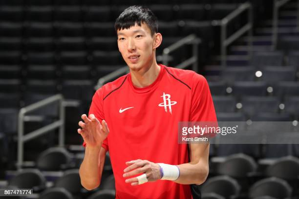 Zhou Qi of the Houston Rockets warms up before the game against the Charlotte Hornets on October 27 2017 at Spectrum Center in Charlotte North...