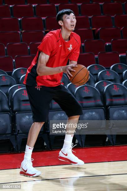 Zhou Qi of the Houston Rockets warms up prior to the preseason game against the Shanghai Sharks on October 5 2017 at the Toyota Center in Houston...