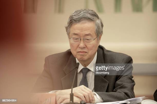 Zhou Xiaochuan, governor of the People's Bank of China , attends a news conference at the Great Hall of the People during the 19th National Congress...