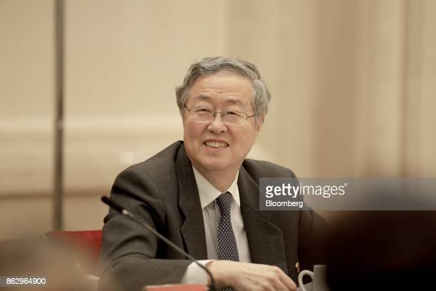 Zhou Xiaochuan, governor of the People's Bank of China , reacts during a news conference at the Great Hall of the People during the 19th National...