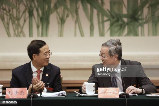 Zhou Xiaochuan, governor of the People's Bank of China , right, and Liu Shiyu, chairman of the China Securities Regulatory Commission, attend a news...