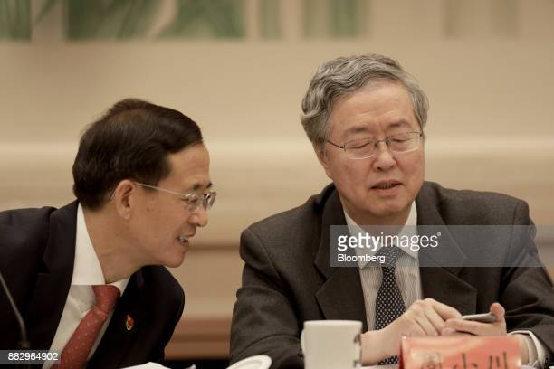 Zhou Xiaochuan, governor of the People's Bank of China , right, speaks with Liu Shiyu, chairman of the China Securities Regulatory Commission, during...